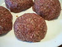 burgers filled with stuffing before grilling