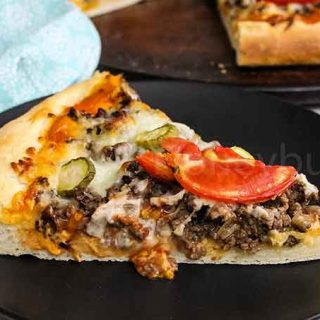 A slice of Cheeseburger Pizza on a plate
