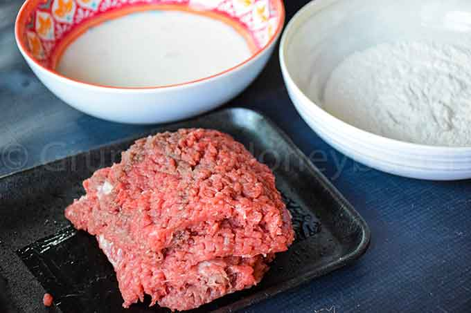 cube steak, milk egg wash, and flour