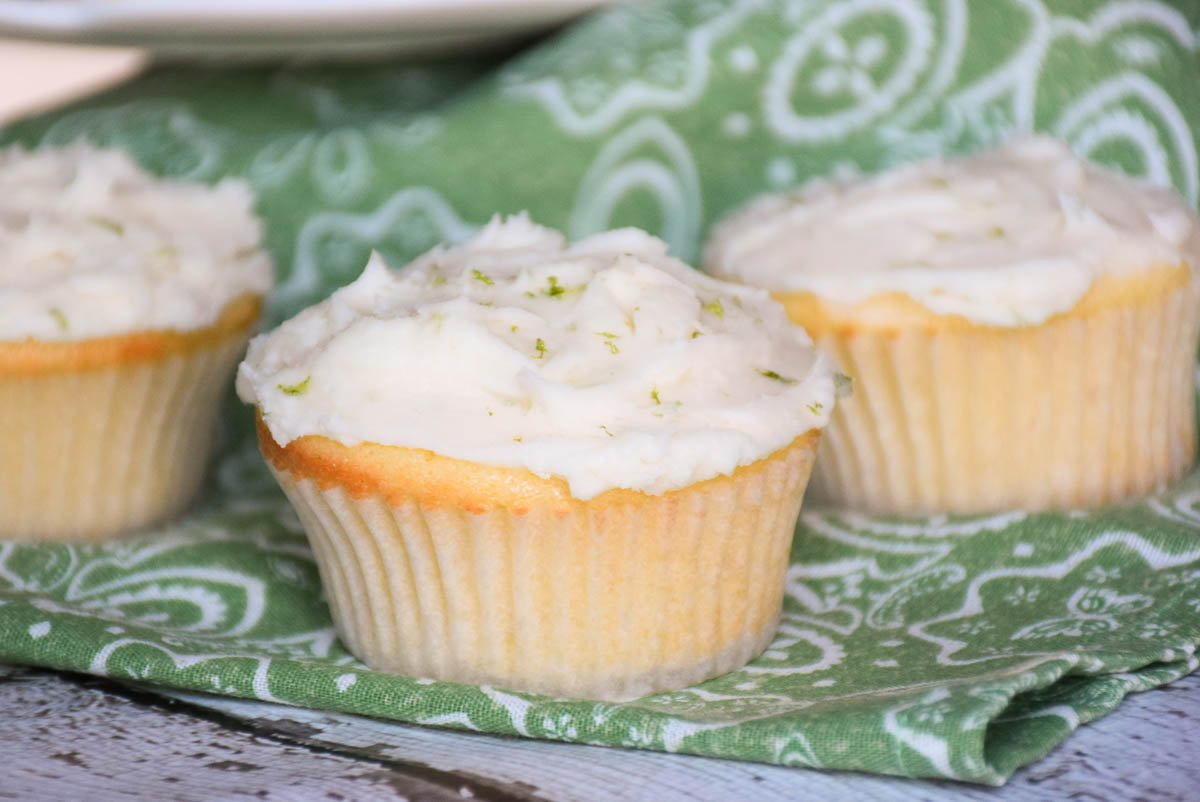 3 cupcakes on a green and white napkin