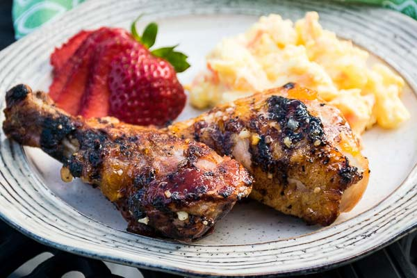 Grilled Apricot Glazed Chicken on a cream colored plate