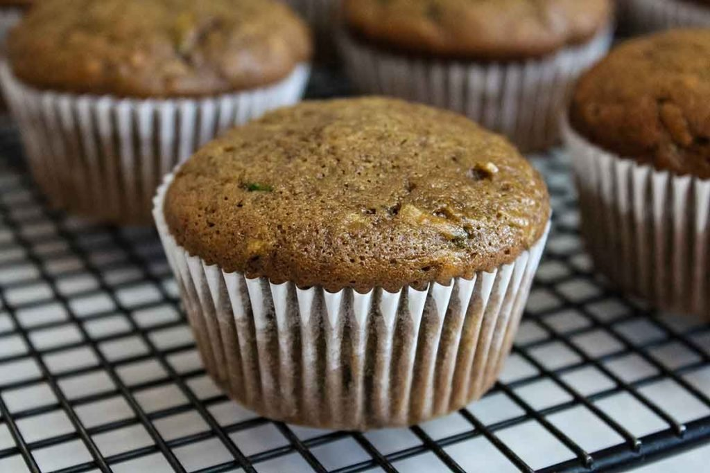Chocolate Banana Zucchini Muffins on cooling rack