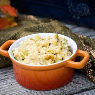 Broccoli Rice and Cheese Casserole in an orange dish