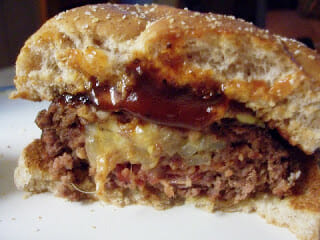 Cheese Stuffed Burger cut in half