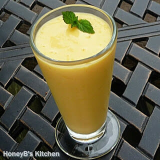 Mango Lassi with a mint garnish