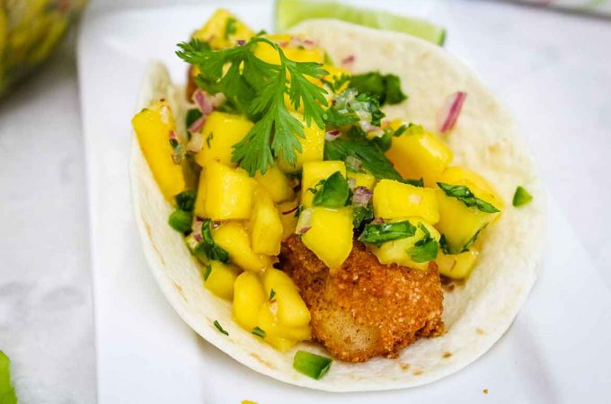 Flour Tortilla filled with fried cod strips and mango salsa