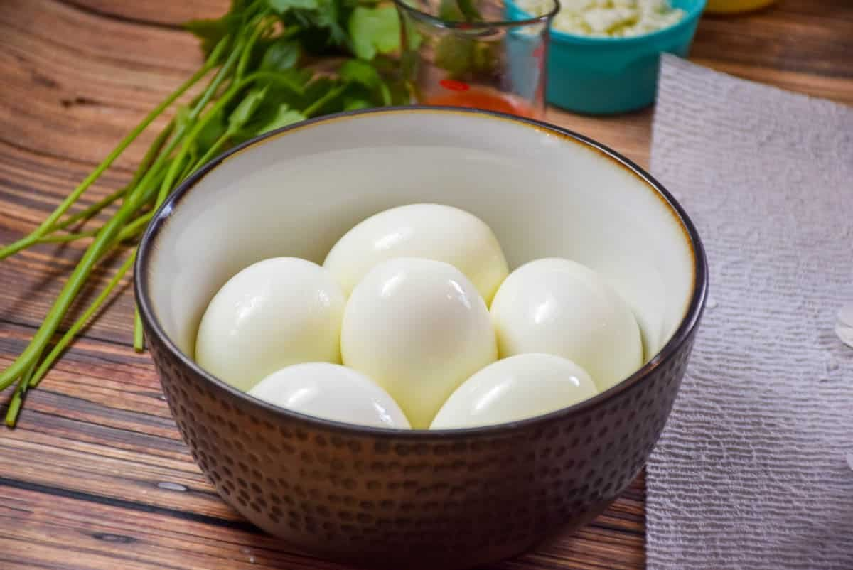 A bowl with hard boiled eggs, shells removed