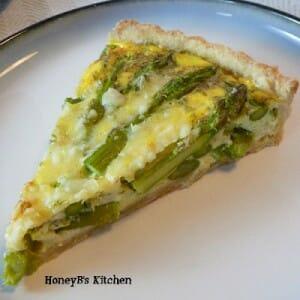 A cut slice of Asparagus Tart