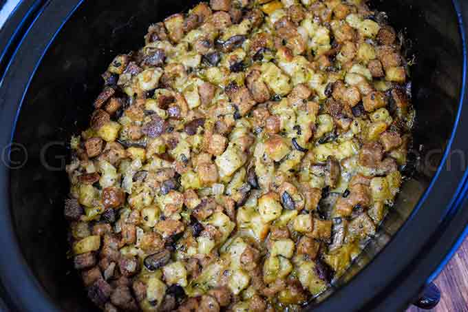 overhead view of cooked crockpot stuffing in the crockpot