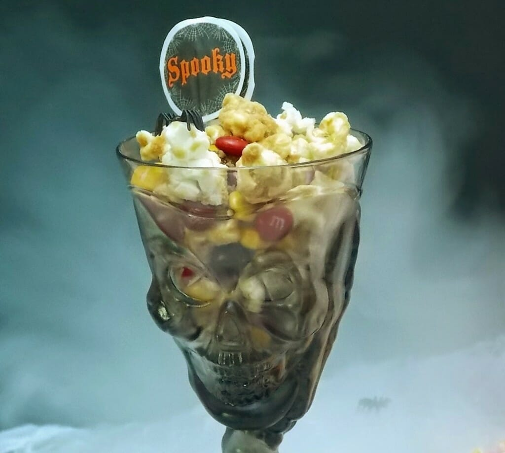 A skeleton cup full of snack mix