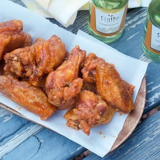 Crispy Maple Hot Wings - a tray of double fried chicken on a serving platter