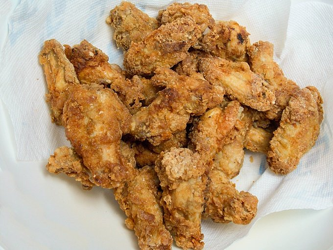 A basket of Double Fried Crispy Wings without the sauce added