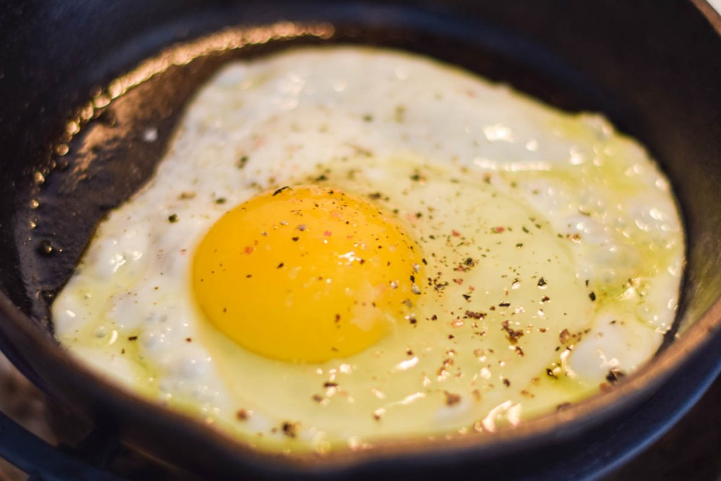 egg frying in skillet