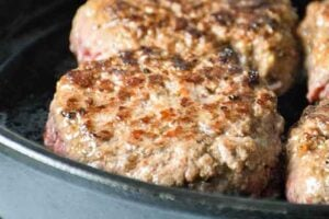 cooked beef patties in the skillet