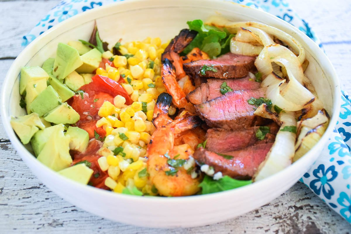 Harissa Marinated Steak and Shrimp Salad with Cilantro Lime Dressing