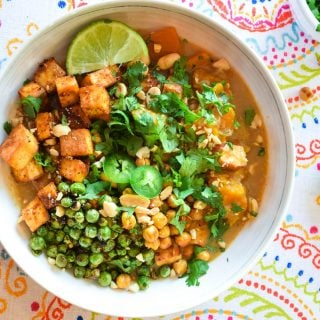 Overhead view of Coconut Curry Tofu bowl on a colorful placemat