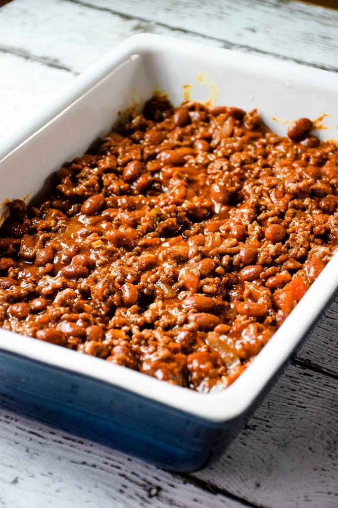 Chili layer over top of hot dogs in casserole dish