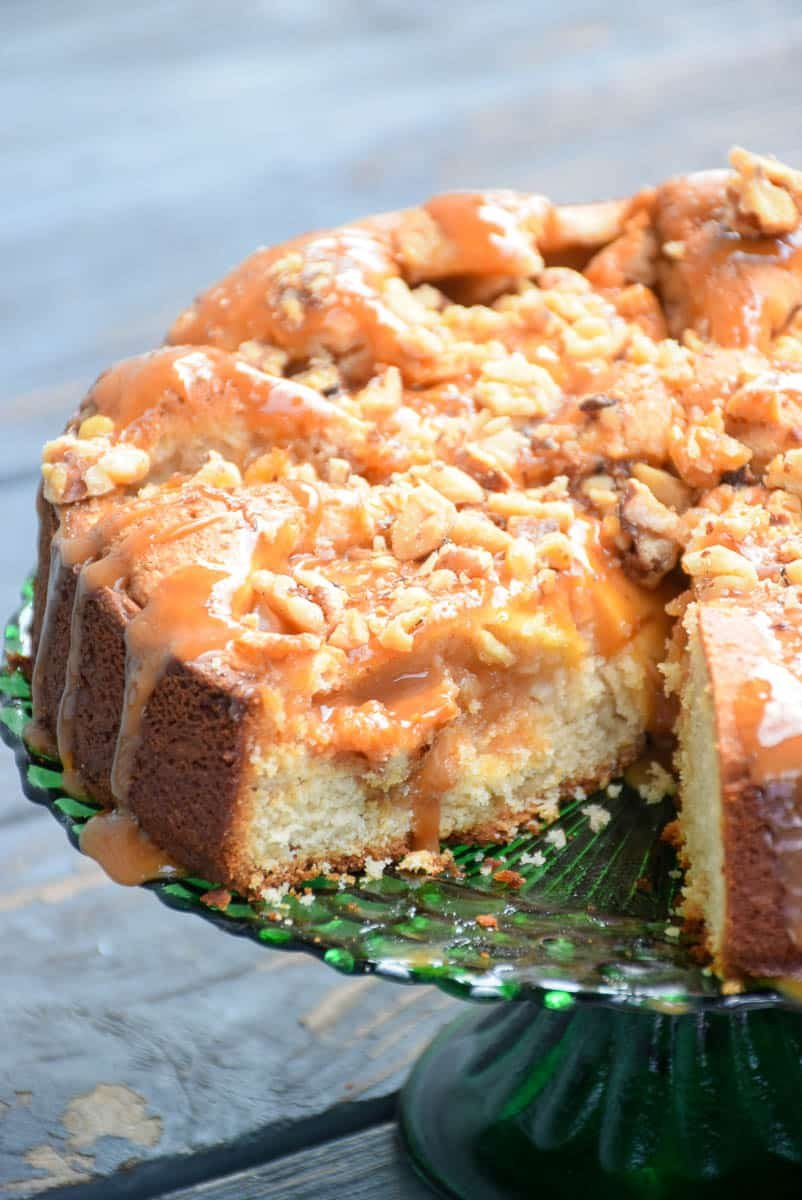 Salted Caramel Apple Cake on a green cake plate.