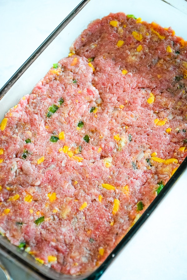 meatloaf mixture packed into meatloaf pan