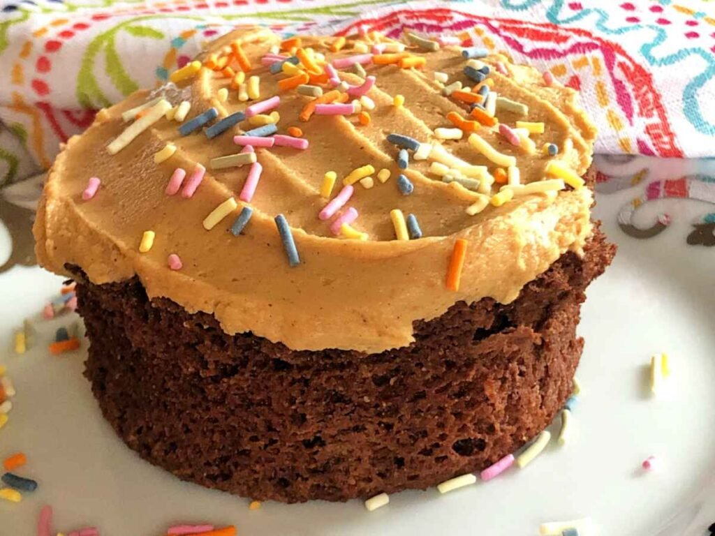 Cake version with a sugar free peanut butter frosting on top with pastel colored sprinkles