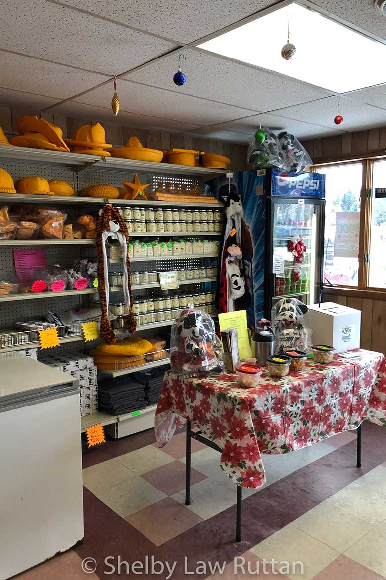 Cheese Sample Stations are set throughout the store.