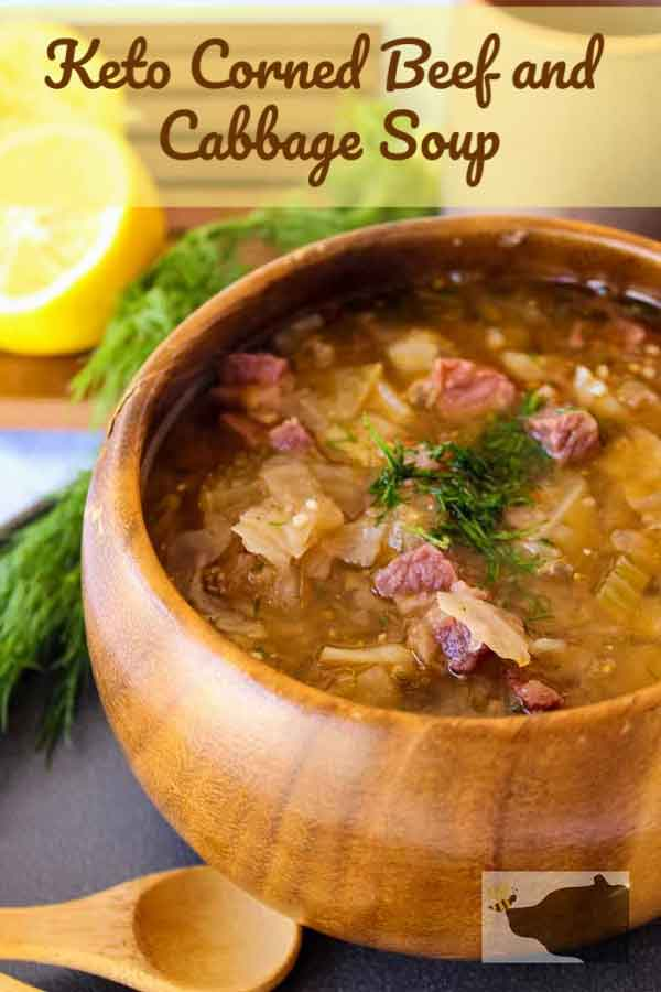 Corned Beef and Cabbage Soup in a wooden bowl pinnable image