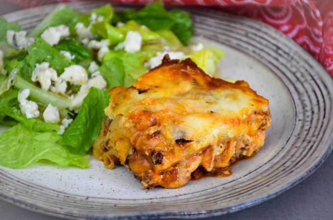 Low Carb Lasagna slice on plate with side salad
