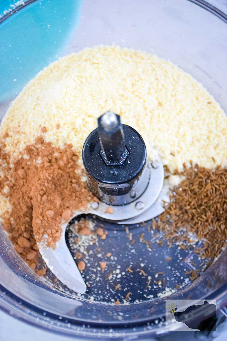 Flours, baking cocoa, and caraway seeds in food processor before blending