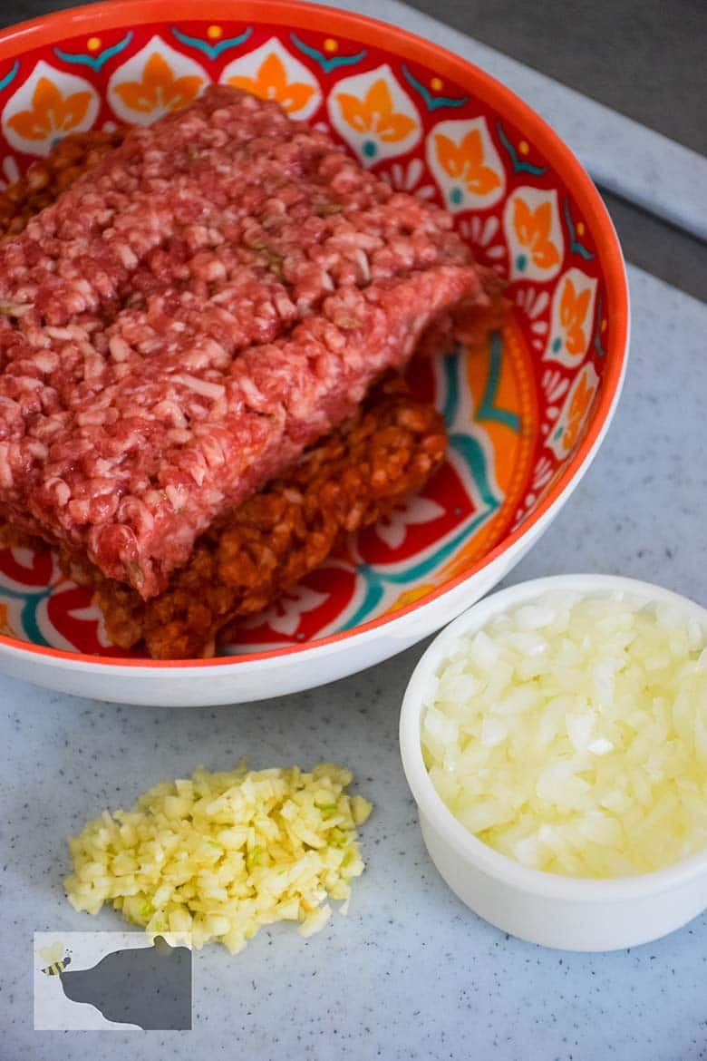 ground sausage, minced garlic and diced onion prepared to go in the skillet