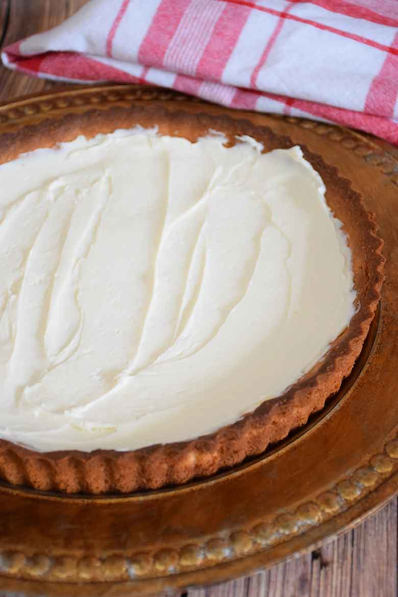 Almond Cream filling spread over baked tart.