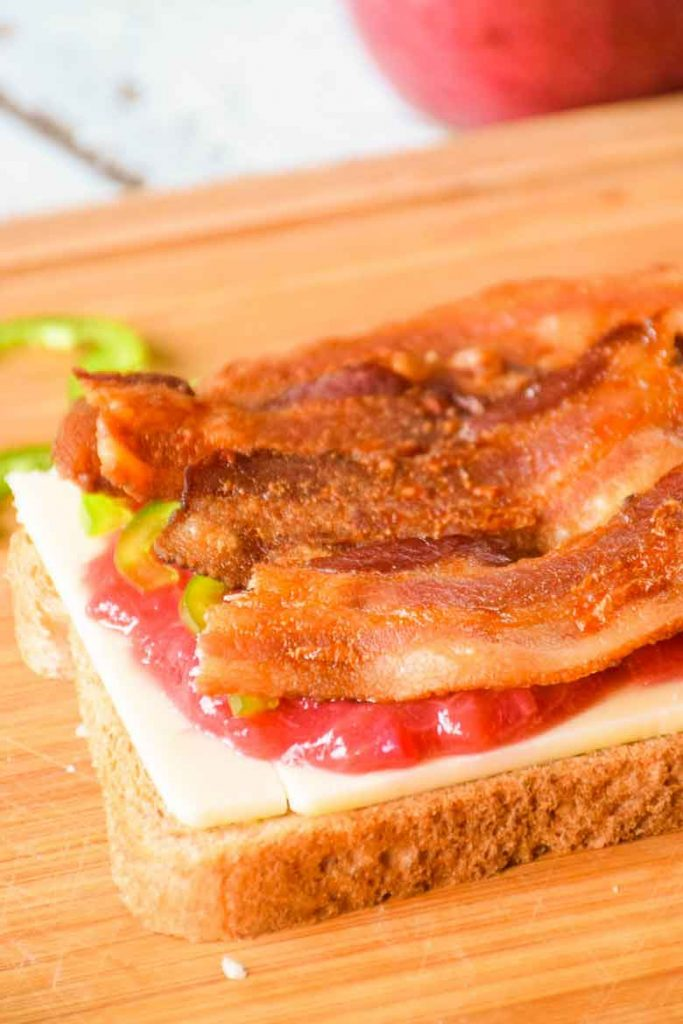 bottom layer of sandwich with bacon on top of rhubarb sauce recipe and jalapenos