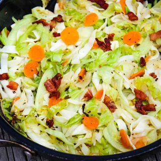 Cabbage Noodles with bacon in skillet
