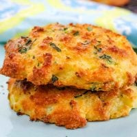 Two Low Carb Biscuits with Zucchini and Cheese on a blue serving plate