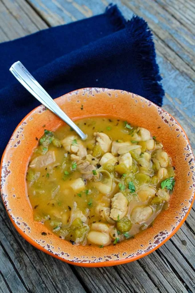 Easy White Chicken Chili in an orange bowl with a blue napkin