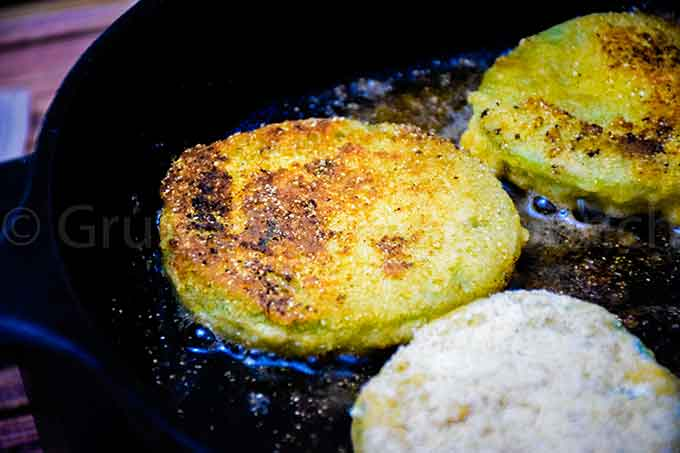 frying green tomatoes in a skillet