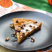 A slice of Pumpkin Spice Dutch Baby Pancake on a black plate