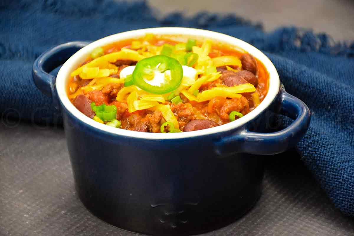 Beef Chili in a serving bowl with chili toppings