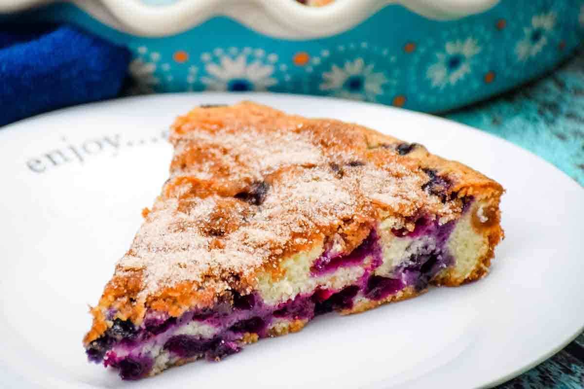 A slice of Blueberry Coffee Cake with Cream Cheese on a white plate - featured image