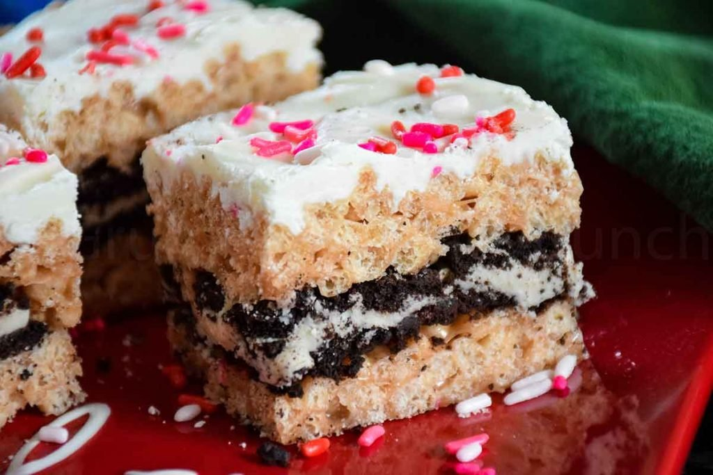Oreo Stuffed Rice Krispie Treats on a red plate with a green napkin