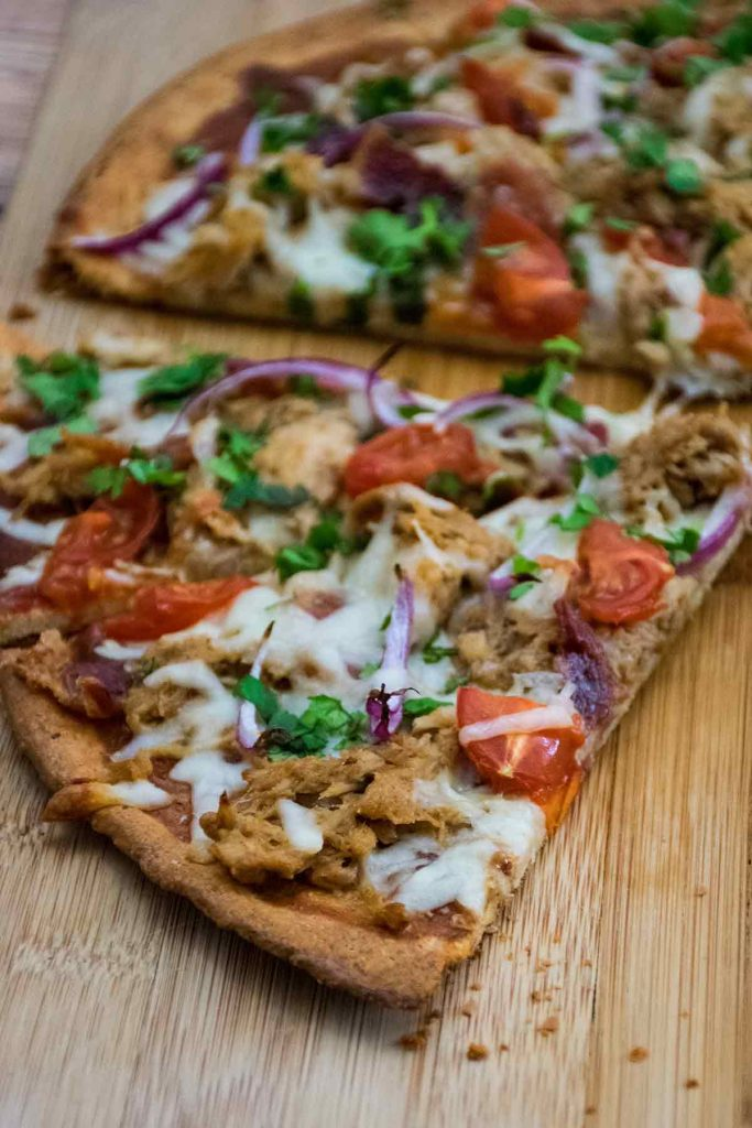 baked low carb pizza crust with pulled pork topping