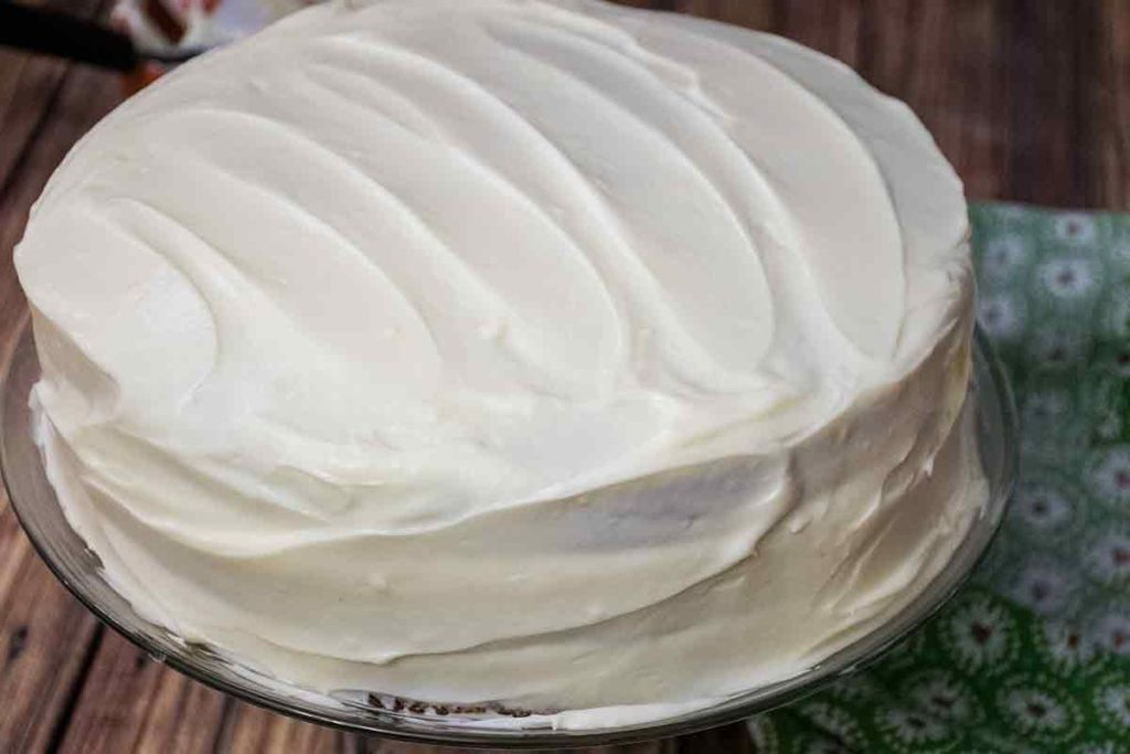 a cake frosted with cream cheese frosting
