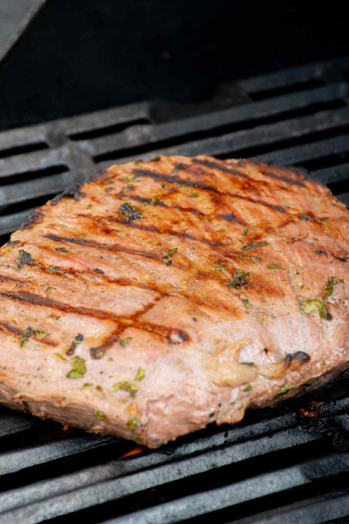 marinated flank steak on the grill