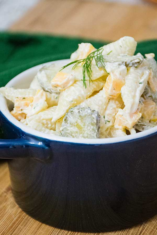 Dill Pickle Pasta Salad in a blue serving bowl
