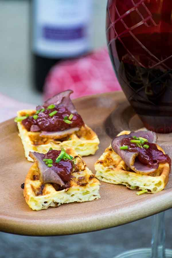 Duck Appetizer Chaffle with Rhubarb Topping on a serving tray with a bottle of CK Mondavi wine in the background