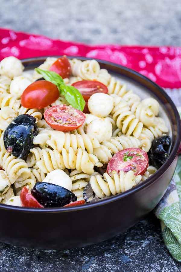 A bowl full of pesto pasta salad
