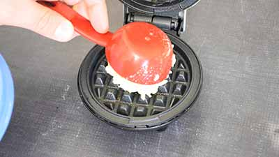 adding the chaffle batter to the waffle iron
