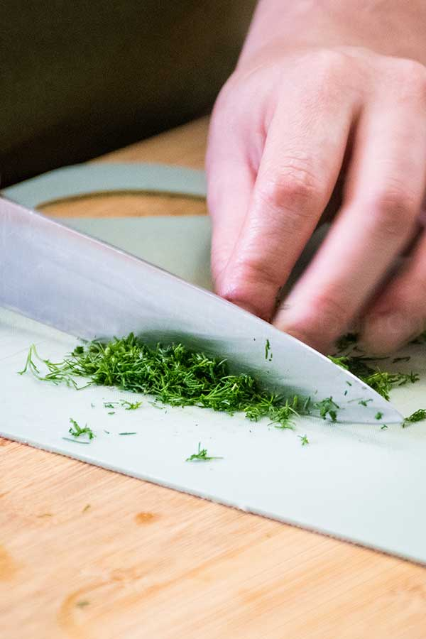 chopping fresh dill