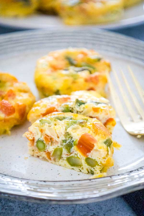 asparagus and tomato egg muffin cups on serving plate