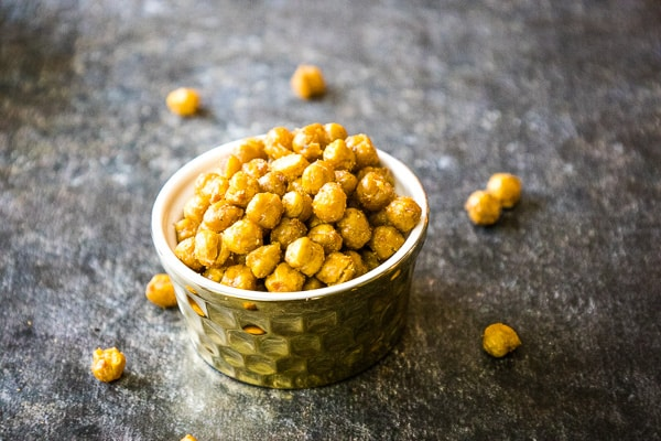 oven roasted chickpeas in a gold serving dish