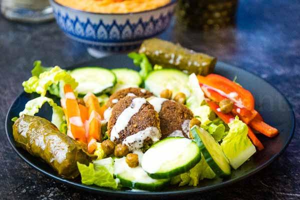 tahini salad dressing recipe on a falafel salad.